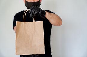 Delivery man employee in black cap blank