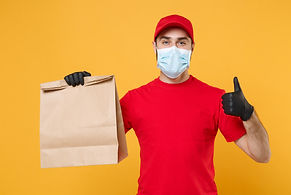 Delivery man employee in red cap t-shirt
