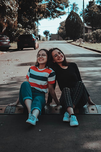 photo-of-two-women-sitting-on-road-24650