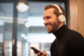 man-wearing-white-headphones-listening-t