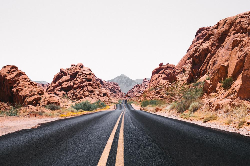 Paved road through red rock desert