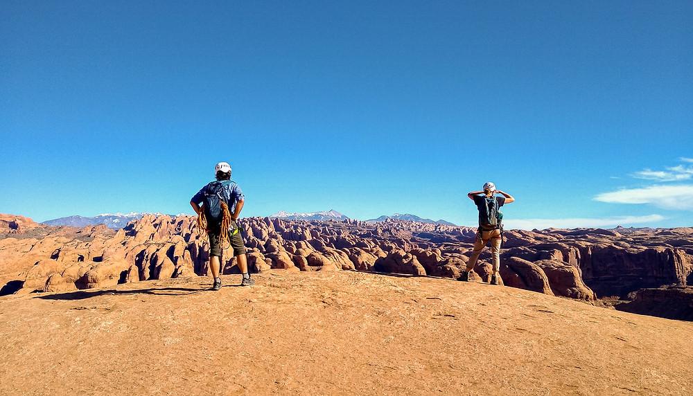 Two people looking at desert vista.