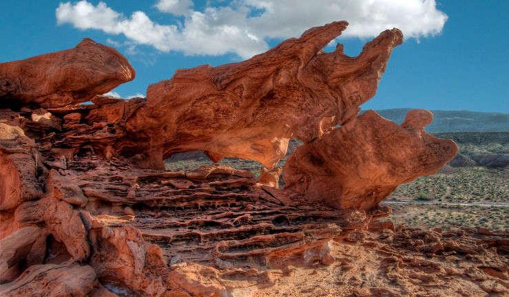 Red rock form in desert.