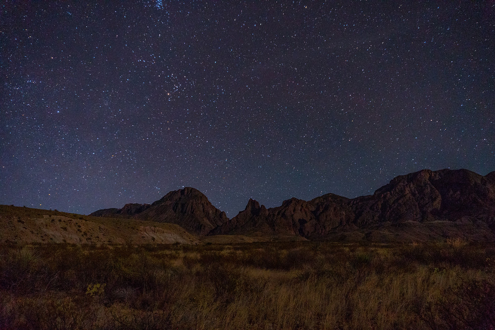 Starry sky behind desert landscape in Texas