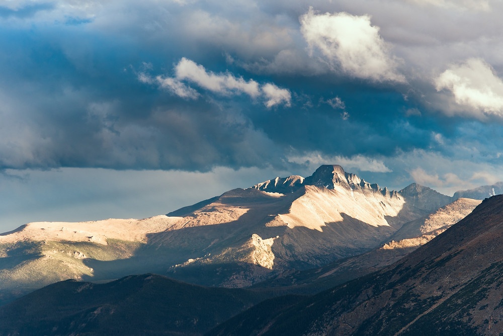 Mountain peaks in sunlight with dark clouds