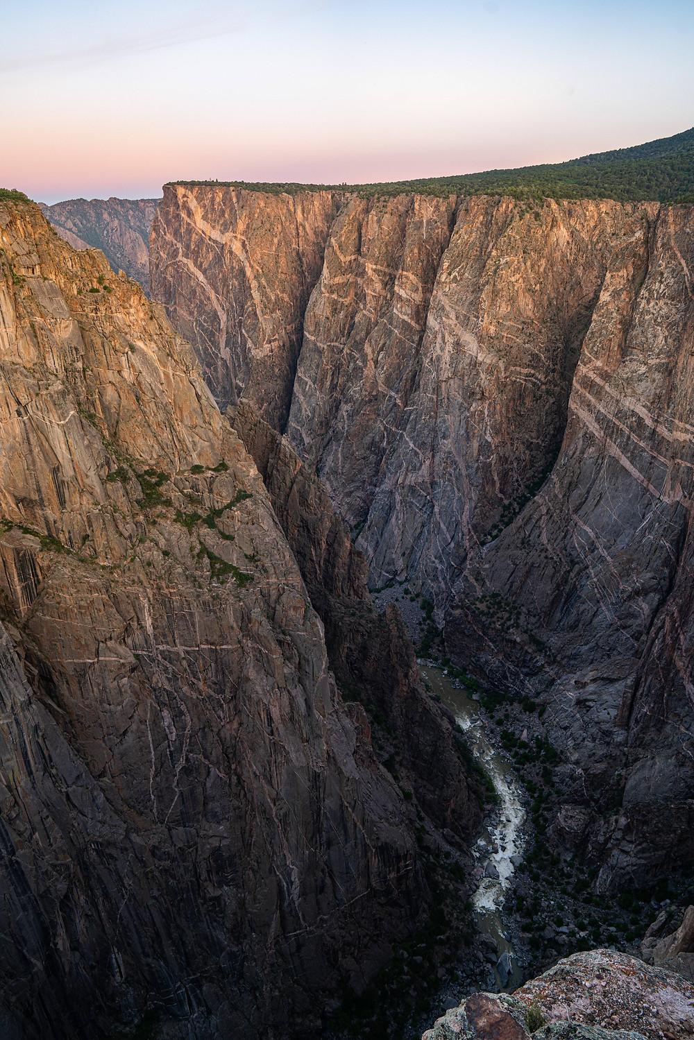 High sheer walls of a river canyon.