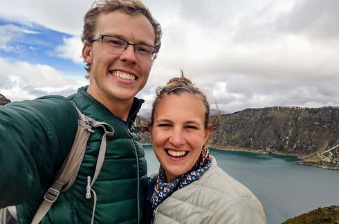 two people in front of lake