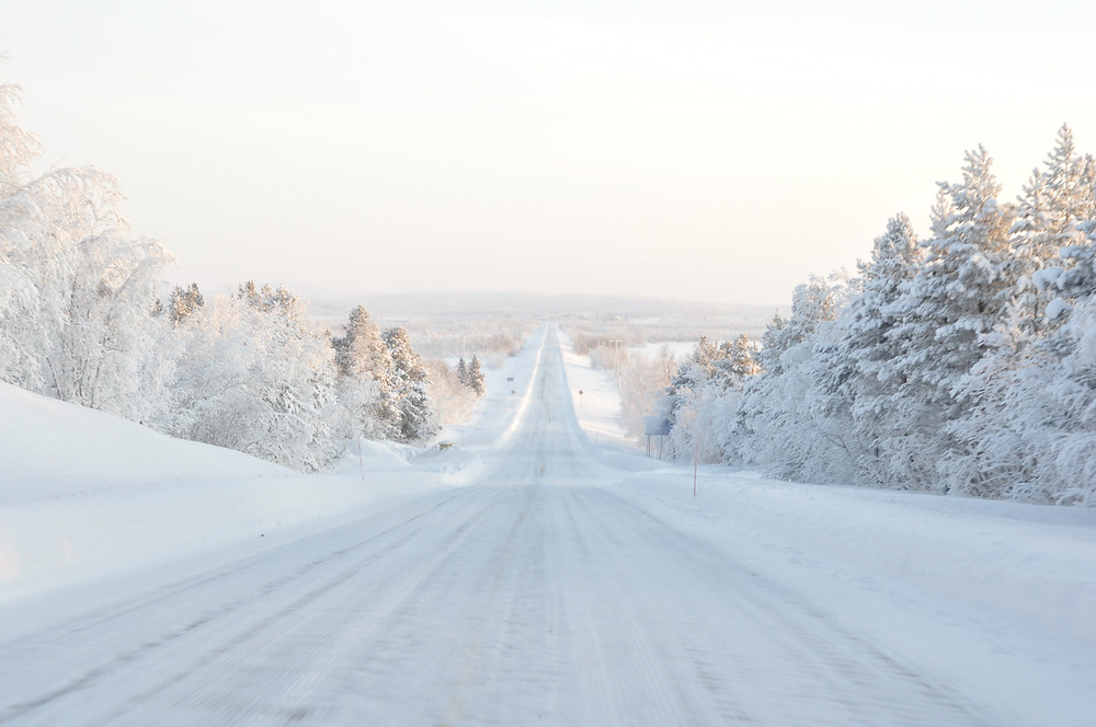 Snow covered road in Finland