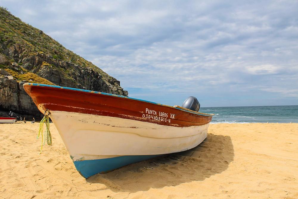 Boat on sandy beach.