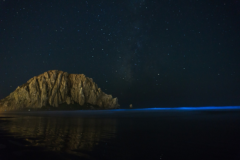 Rock on coast at night time.