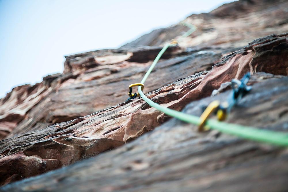 Rock climbing gear of rock face in desert.