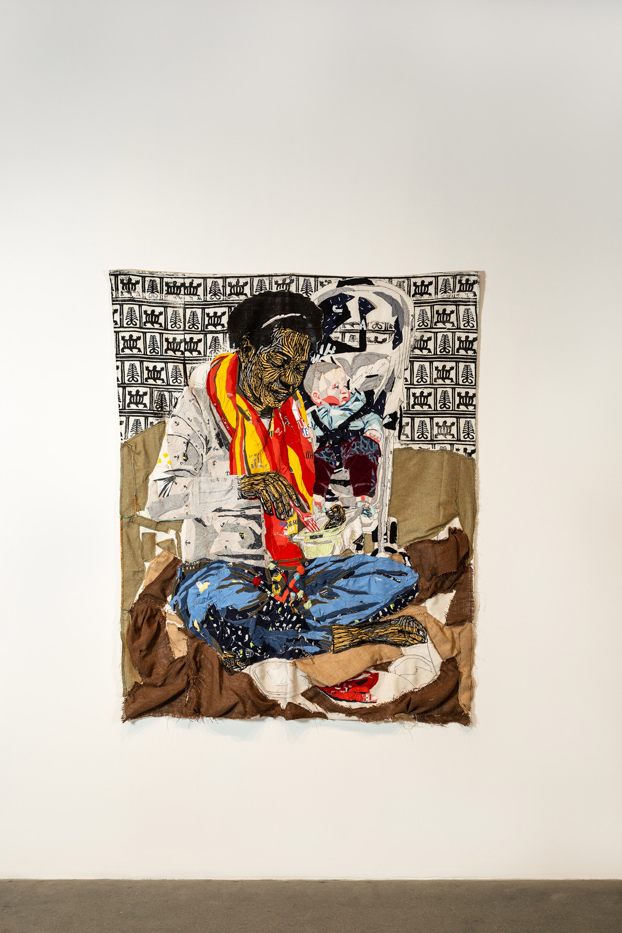 "Krystle Lemonias, ""Yuh no see say Him hungry,"" 2019. Baby clothes, woodblock print on fabric, 57 x 90 in, 11 lbs. Photo by Mariana Sheppard"