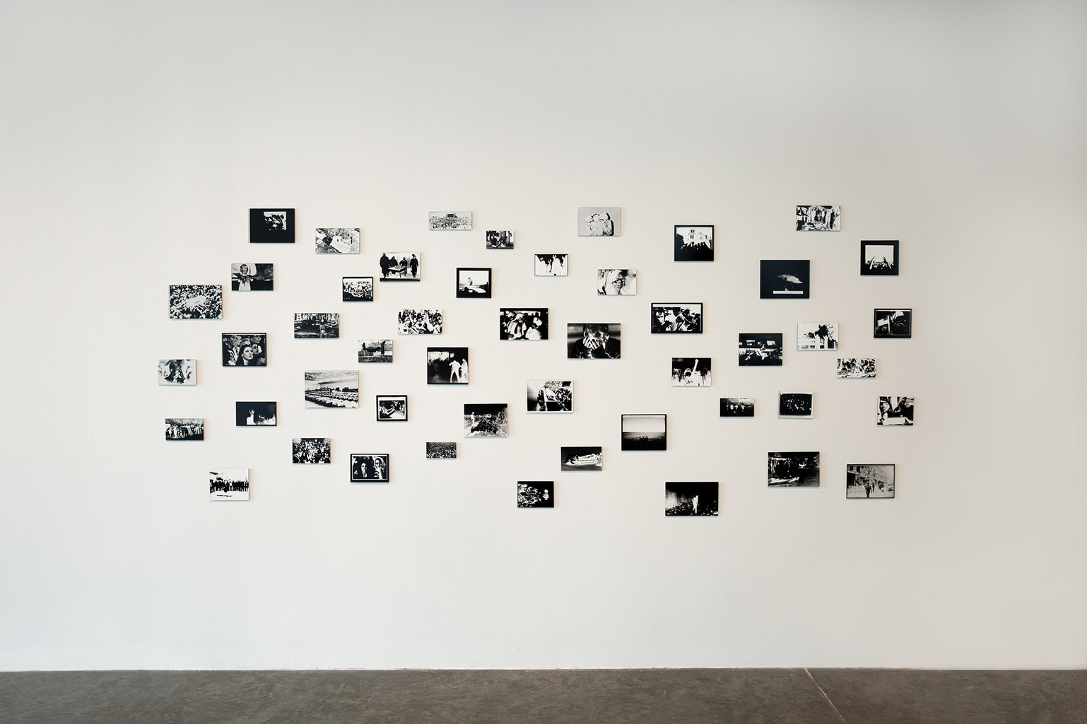 "Kristine Thompson, ""Images Seen to Images Felt,"" 2019. Installation: gelatin silver print photograms exposed by the light of a laptop screen, each print mounted to dibond 84 x 84 in. Photo by Mariana Sheppard"