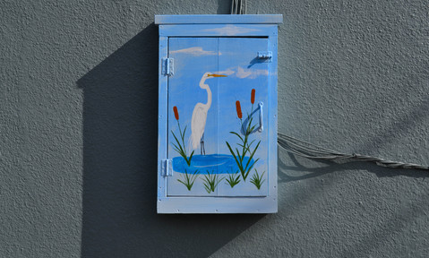 Egret on small telephone box