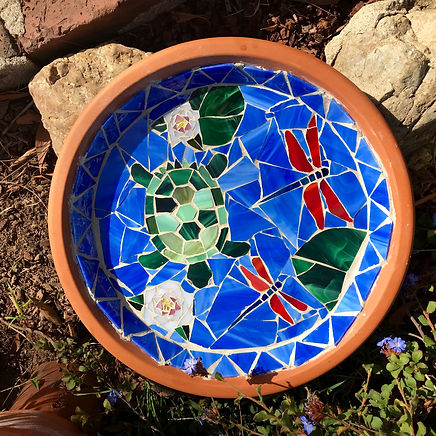 I smile each time I look at my colorful stained glass birdbath, custom made by Nora. Her creations are gorgeous and fairly priced. She patiently guided me as I chose my favorite colors and decided to include a turtle and dragonflies in the design. Nora envisioned the rest, executed beautifully and delivered ahead of schedule.  She has a keen eye and impeccable taste and I enjoyed working with her. Thank you Nora! Susie P.