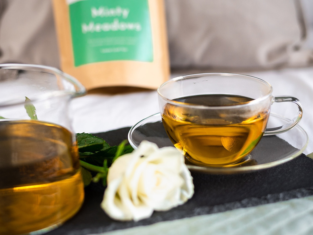 Drink herbal tea before bed with teacup and mint tea