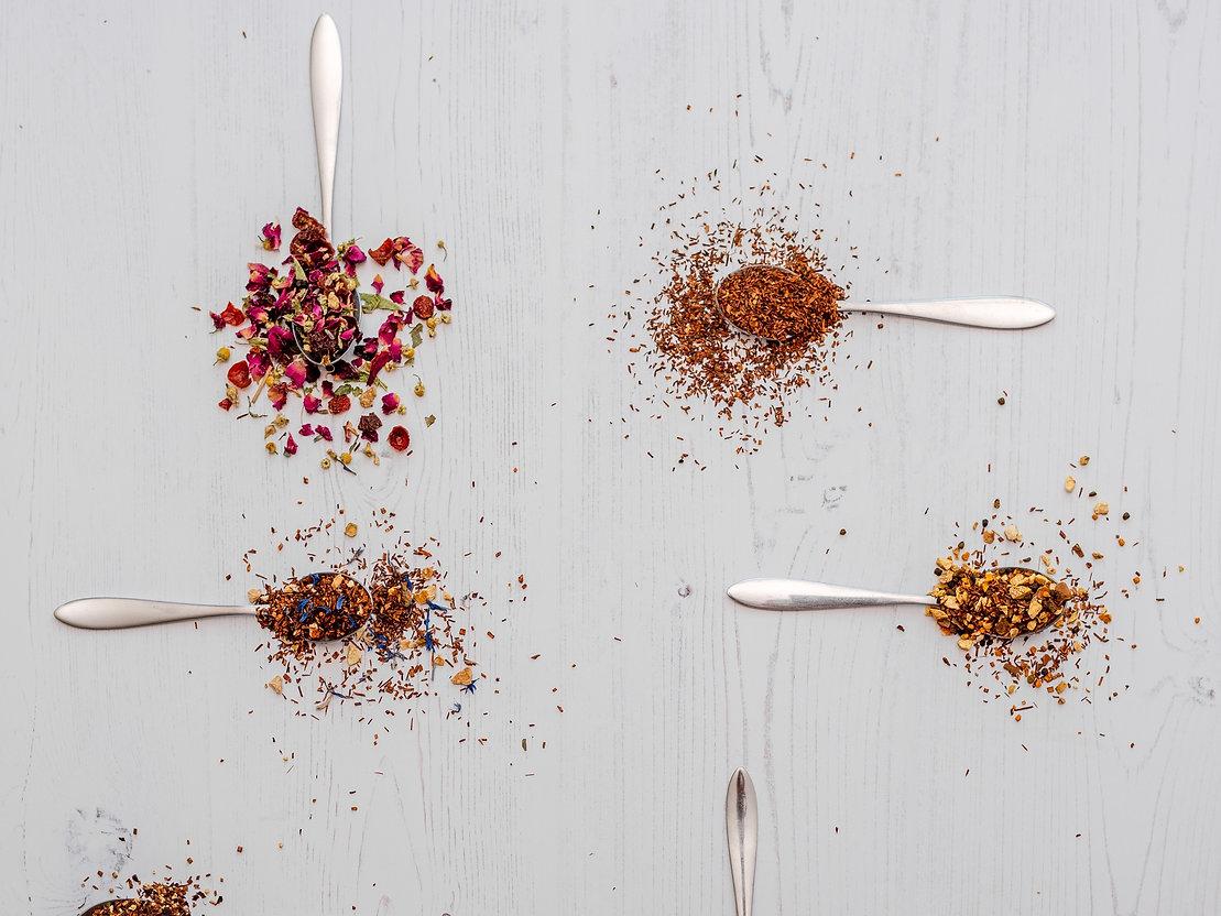honeybush and rooibos tea with teaspoons