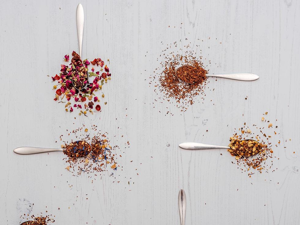 Herbal loose tea on teaspoons