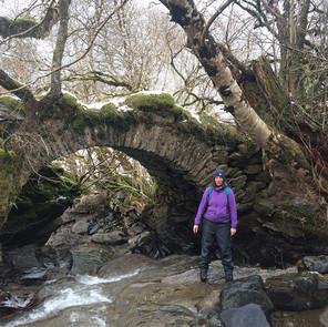 Ancient settlement bridge behind Firbush