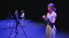Actors; Sydney Hallett, Armin Panjwani, and Esther Soucoup, performing.