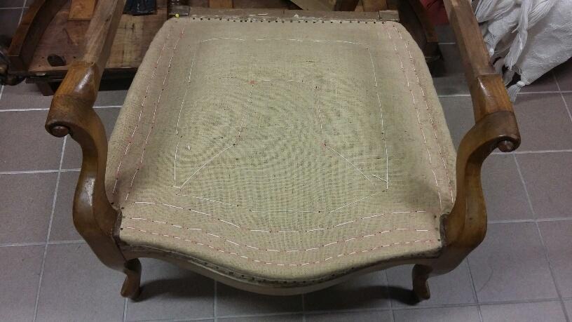 PIquage d'une assise de Voltaire