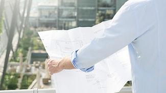 Architect holding plans