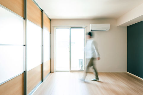 person in air condtitioned large room split system