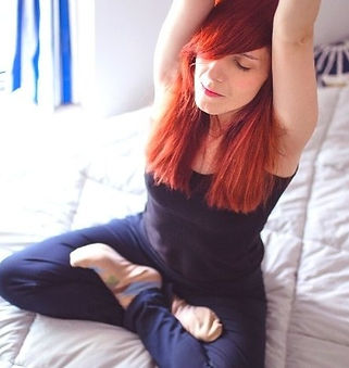 woman-practicing-yoga-in-bed_edited.jpg