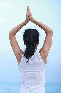 woman standing in mountain pose, yoga