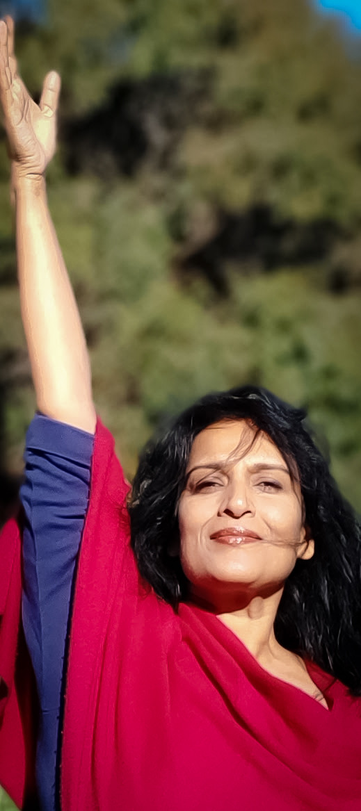 Kamini Desai doing a variation of Tadasana or Mountain Pose. Demonstrating the Integrative Amrit Method of Yoga