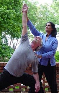 Kamini Desai guiding alignment for student at the Amrit Yoga Institute
