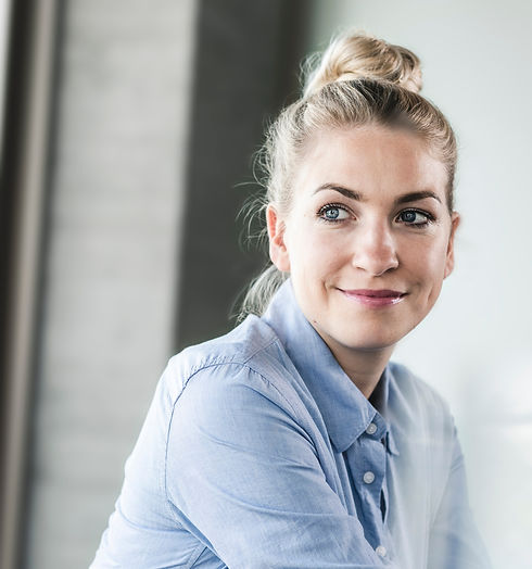 white business woman smiling with confidence