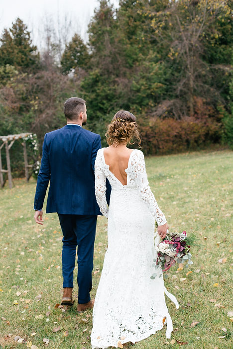 bride-and-groom-walking-on-the-grass.jpg