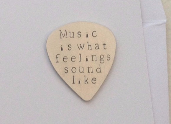 Music is what feelings sound like - Guitar Plectrum