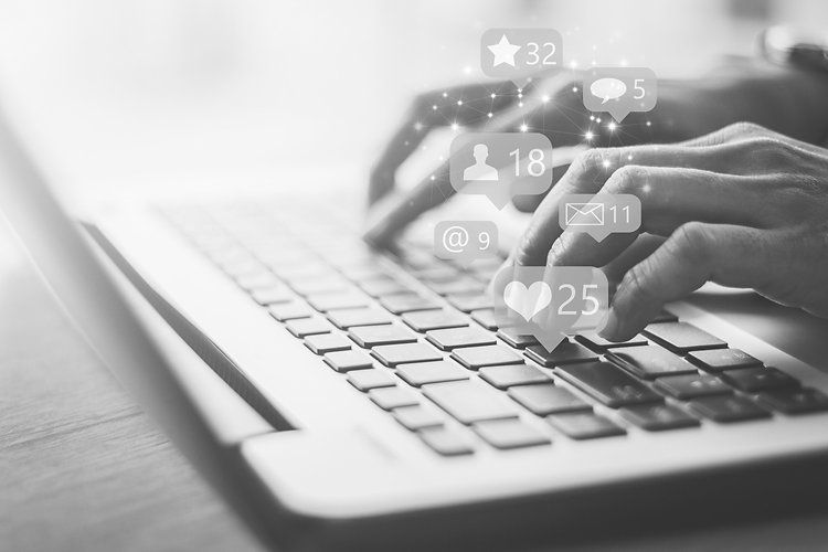 Tick_Tock_South_Virtual_Assistant_Services_Black_White_Photo_Hands_Typing_Social_Media