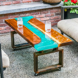 Epoxy and wood coffee table with steel legs