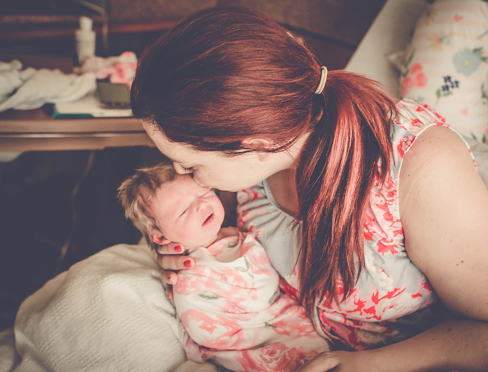 newborn baby girl and mom