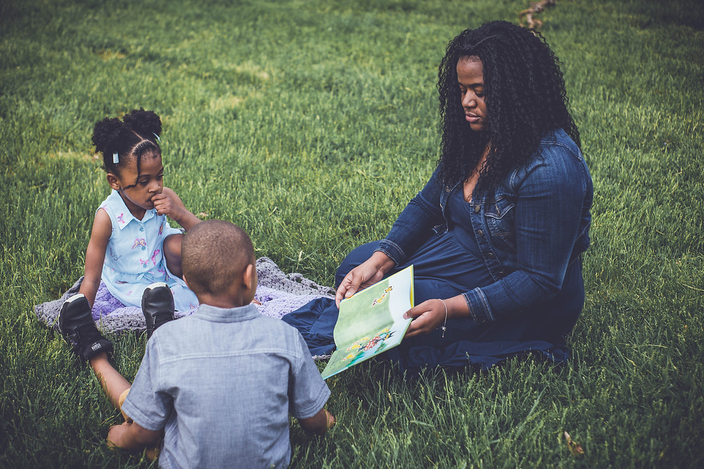 mommy reading to brother and sister