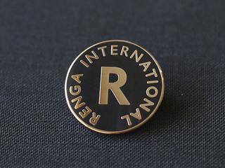 Renga International, enamel badge