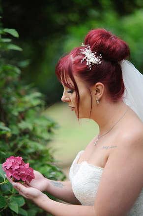 bride-holding-flower.JPG