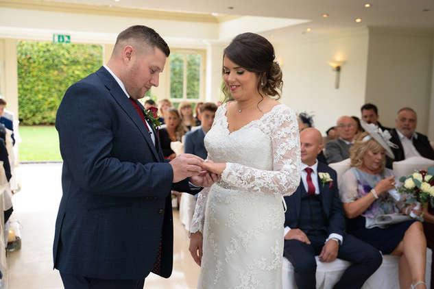 groom-placing-ring-bride.JPG