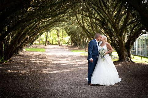 bride-groom-kissing-under-trees.jpg