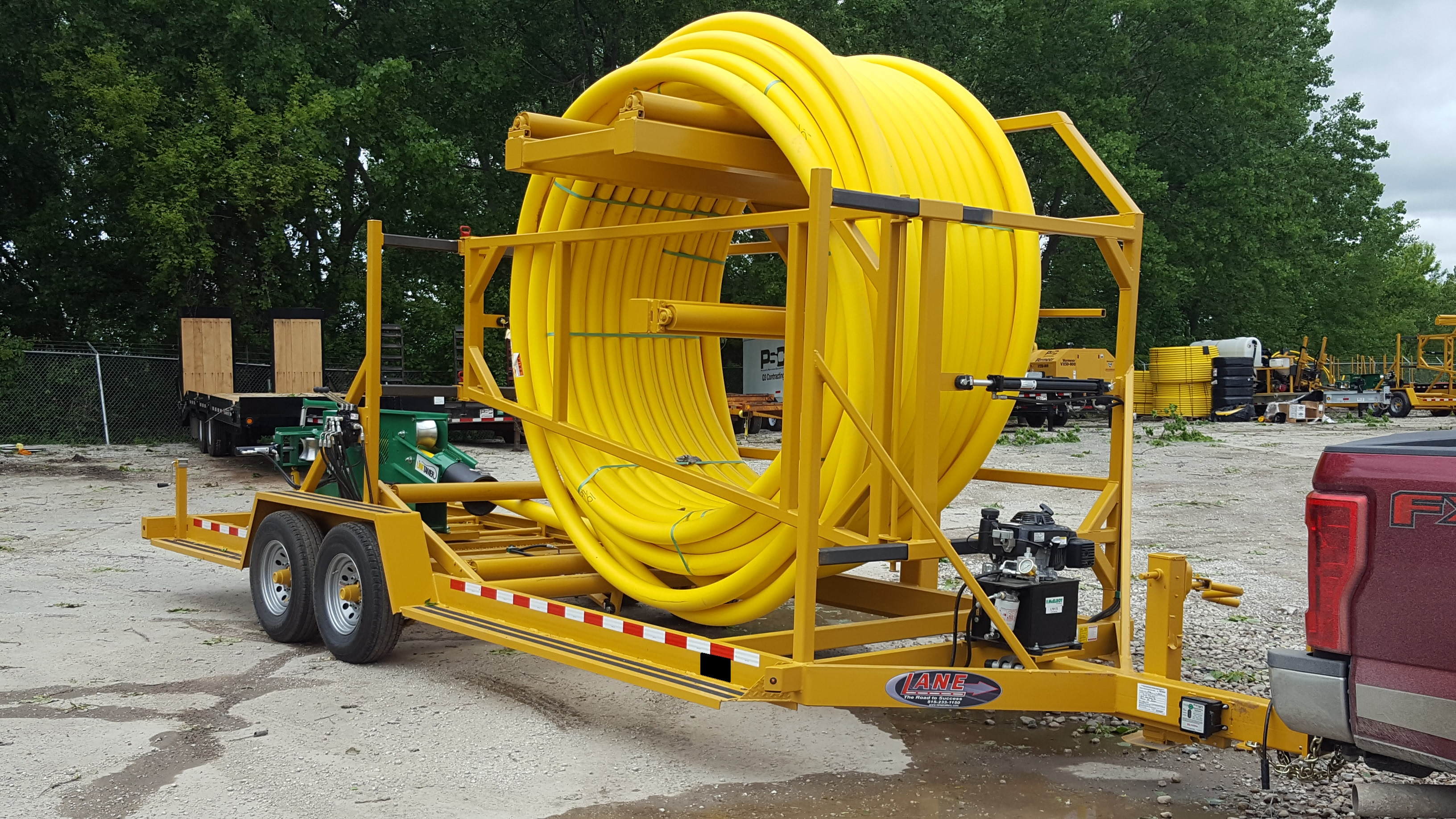 LCV COILED PIPE TRAILER IN USE