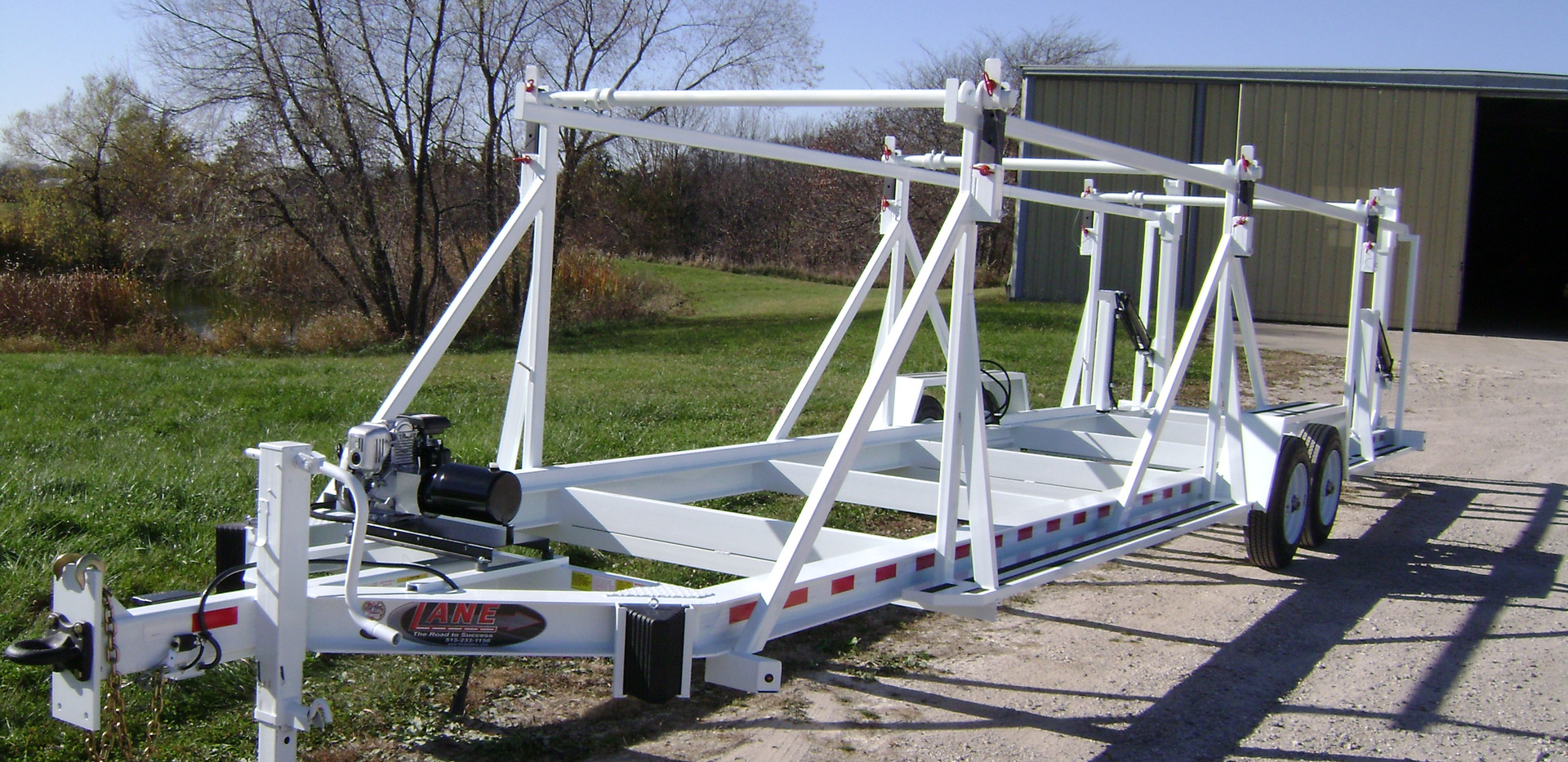 Self Loading Triple Reel Trailer.JPG