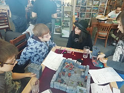 Kids enjoying a game of Dungeons and Dragons hosted by Michael from Mystic Pigeon Gaming