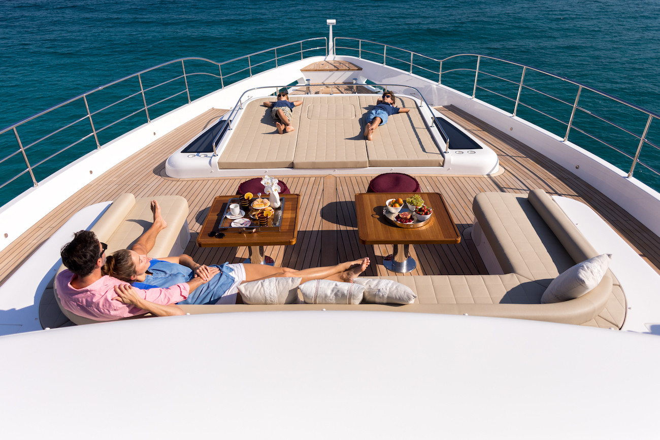 Chilling out on the fore deck during a mega yacht charter