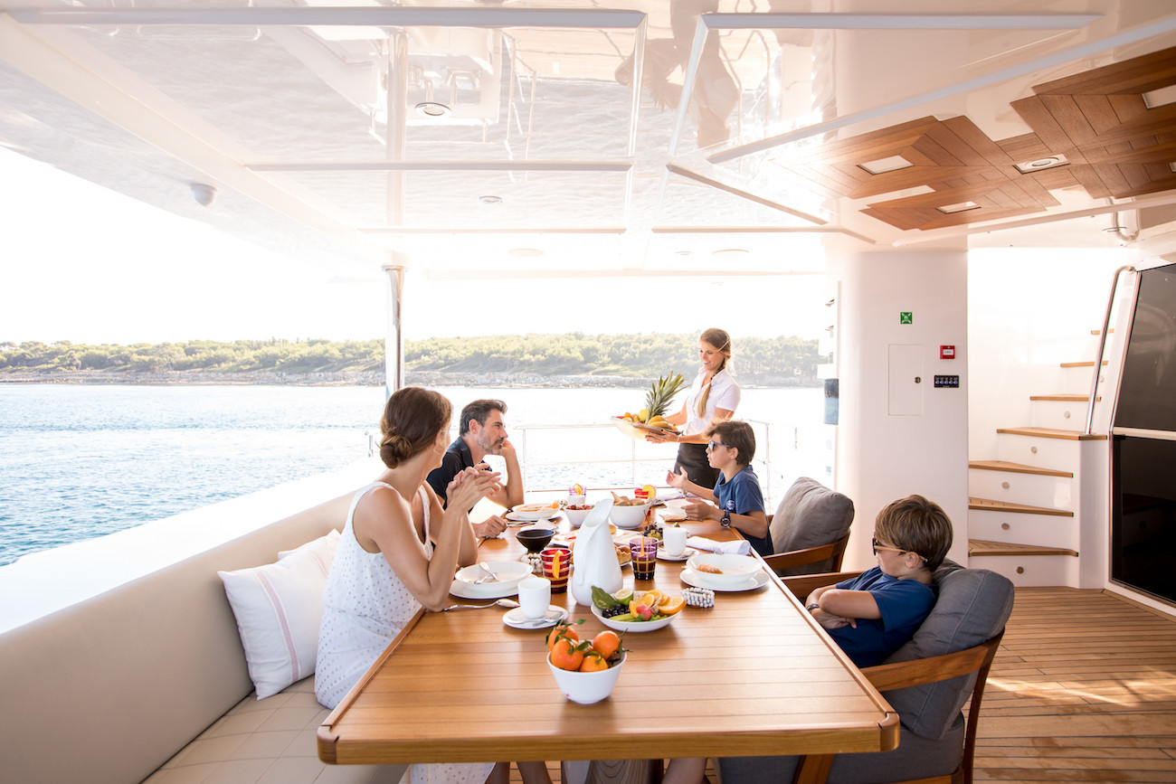 Lunch on the aft deck during a family yacht hire
