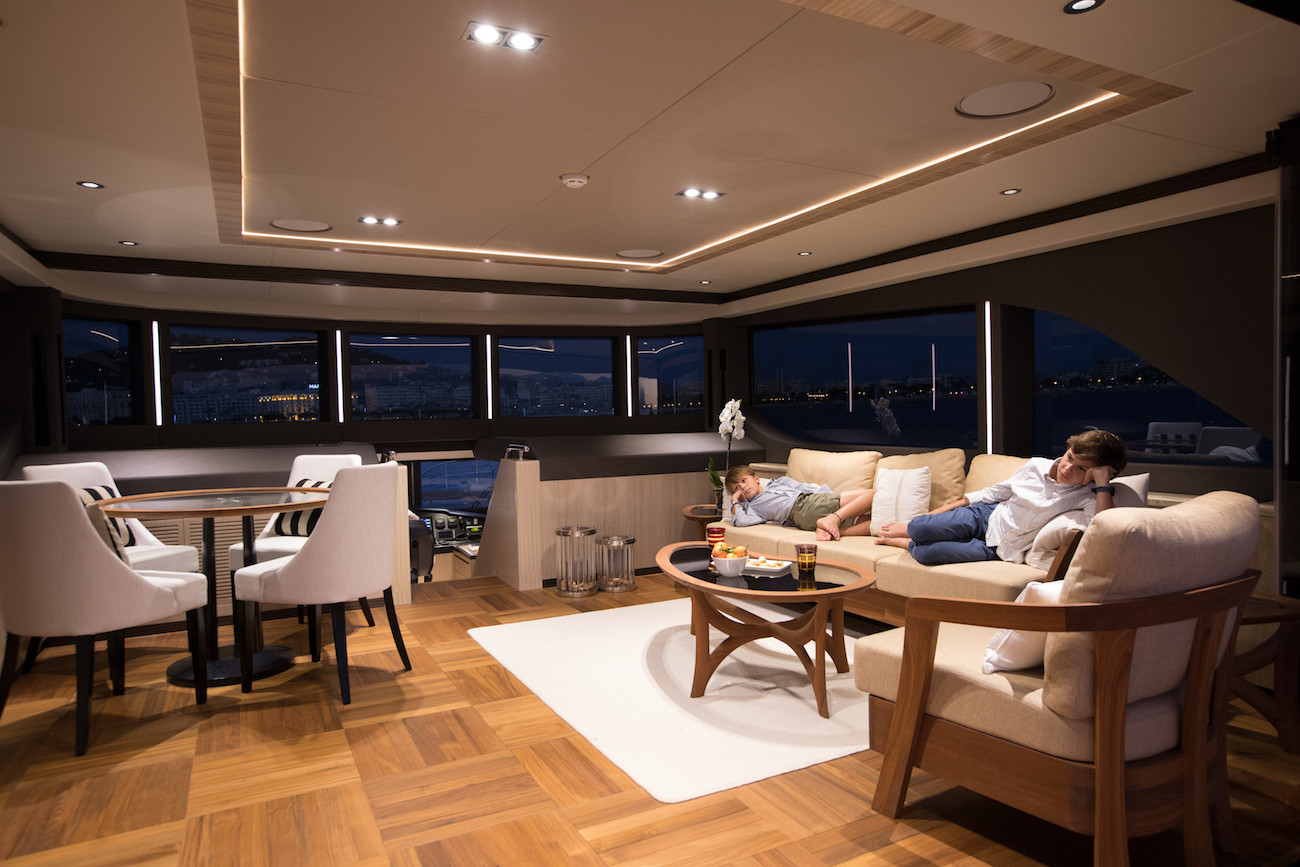 Yacht MIA - bridge deck in the evening, younger charter guests chilled