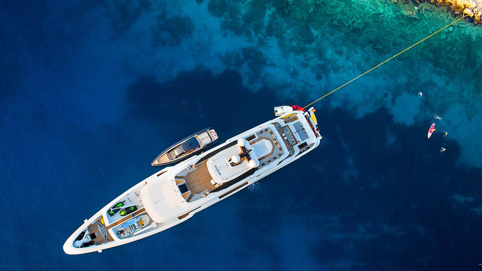 Yacht OURANOS during charter - at anchor with all the water toys and tenders out