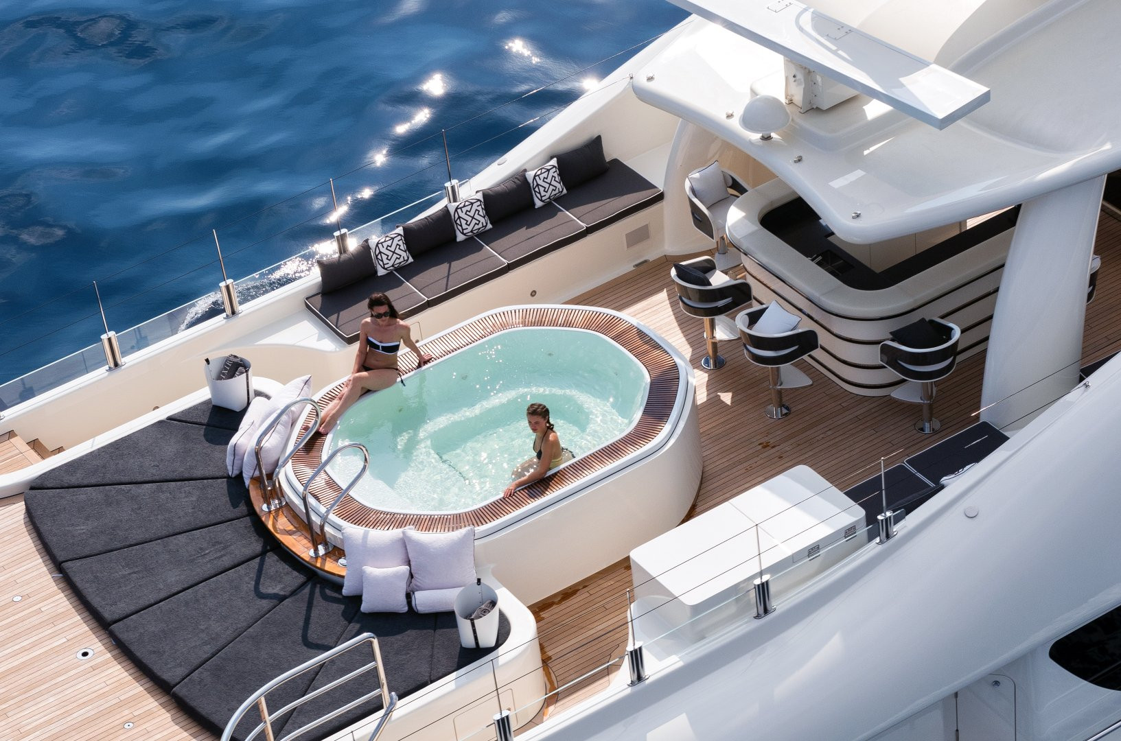 Super yacht ELIXIR - charter guests chilling out in the pool!